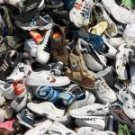 A large pile of various models of shoes