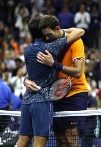 Novak Djokovic and Juan Martin del Potro hugging after the US Open final