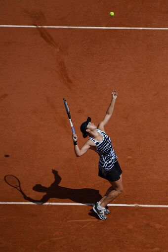 Ashleigh Barty hitting a serve at the 2019 Roland Garros singles final