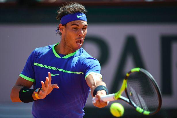 Rafael Nadal hitting at 2017 Roland Garros