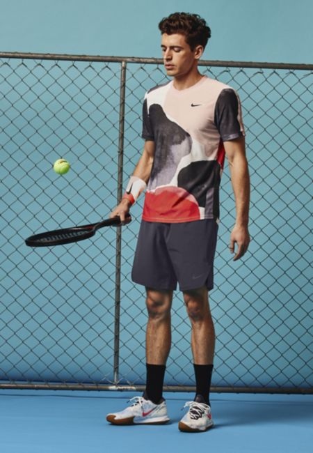 Model in NikeCourt Challenger Short Sleeve Top