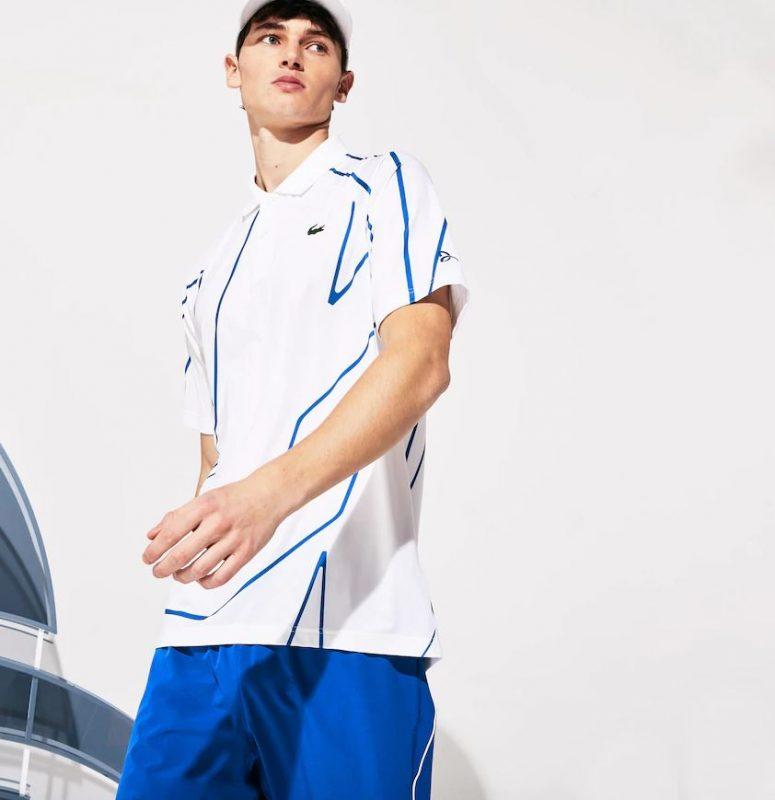 Model in Lacoste Men's Novak Djokovic Ultra Dry Vertical Tennis Polo White and Royal Blue