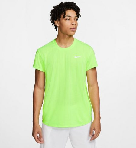 Model in Nike Court Challenger Short Sleeve Tennis Top Ghost Green