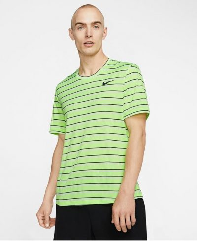 Model in Nike Mens Team Court Dry Graphics Top Ghost Green