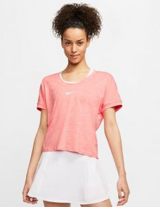 Model in Nike Womens Elevated Essentials Short Sleeve Top sunblush