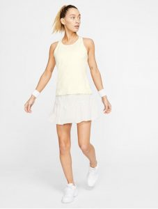 Model in Nike Womens Court Dry Elevated Essentials Tank Light Orwood