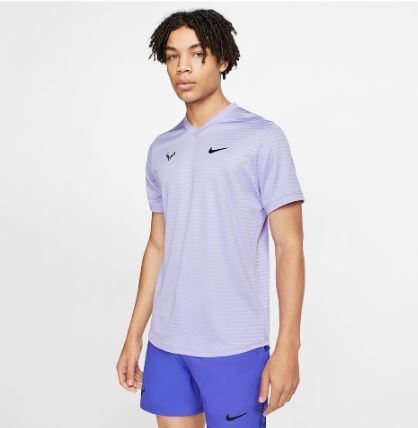 Model in Nike Rafa Court Challenger Short Sleeve Top Purple Pulse