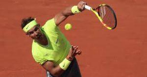 Rafa Nadal serves the ball at Roland Garros