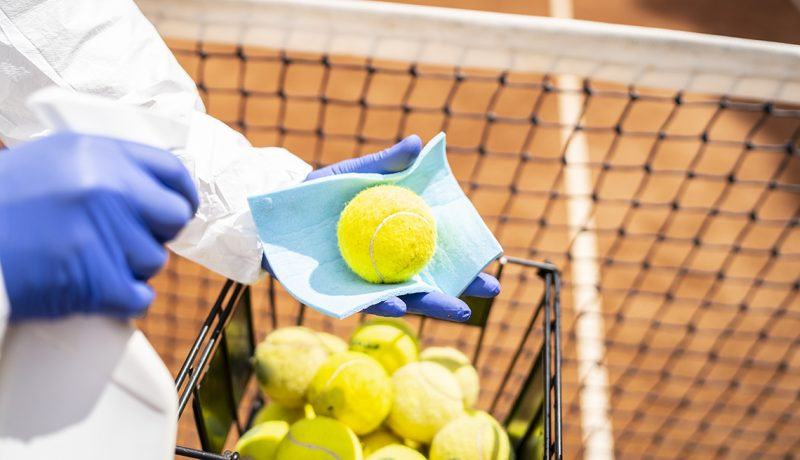 Disinfection of tennis balls close up (VLADIMIR VLADIMIROV / GETTY IMAGES)