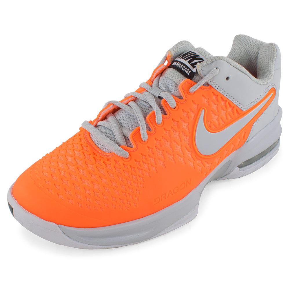 Women`s Air Max Cage Tennis Shoes Atomic Orange and White For a shoe that never disappoints in control the Nike Womens Air Max Cage Tennis Shoes Atomic Orange and White is your best bet These breathable shoes feature a well cushioned midfoot and highly comfortable flexibility