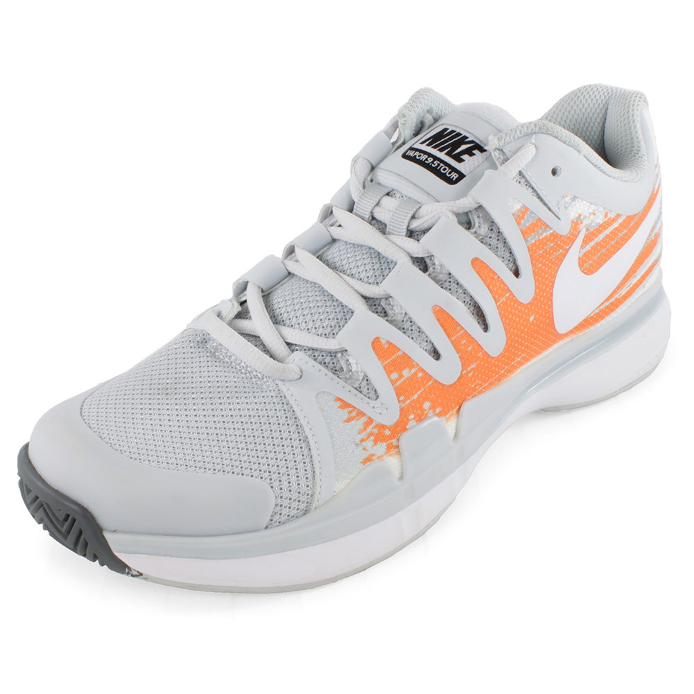 Women`s Zoom Vapor 9.5 Tour Tennis Shoes Pure Platinum and Atomic Orange For the best in lightweight response with incredible feel try the Nike Womens Zoom Vapor 95 Tour Tennis Shoes Pure Platinum and Atomic Orange Designed specifically to fit a womans foot these highperformance shoes are perfect for players looking to enhance