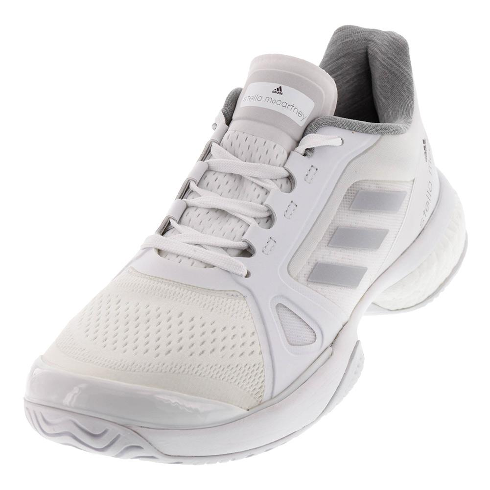 ADIDAS ADIDAS Women s Stella Barricade Boost 2017 Tennis Shoes White And  Solid Gray 67024b882b